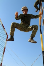 A Mexican competitior drops 15  feet off a ladder during the grueling obstacle course event as part of Fuerzas Comando July 24, 2017, at Vista Alegre, Presidente Hayes, Paraguay. Team Mexico placed third in the event. Special operations personnel from 20 countries participated in the Fuerzas Comando competition, which is designed to improve training, readiness, interoperability, and capability. (U.S. Army photo by Staff Sgt. Chad Menegay/Released)