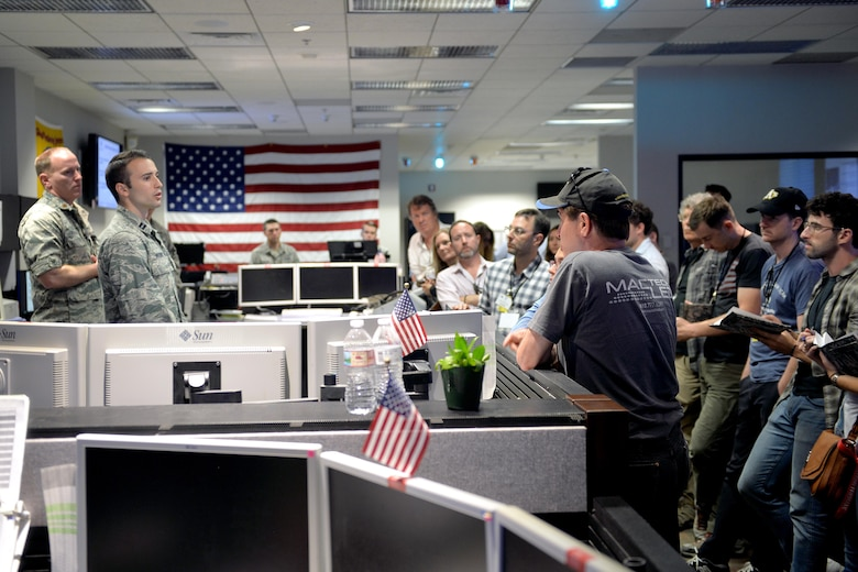 Capt. Jeffrey Wagner, 2nd Space Operations Squadron mission commander, informs Hollywood tour participants about the 2 SOPS mission at Schriever Air Force Base, Colorado, July 17, 2017. Attendees of the tour included directors, producers and writers from acclaimed companies such as Netflix, Marvel Studios and Warner Brothers. (U.S. Air Force photo/Dennis Rogers)