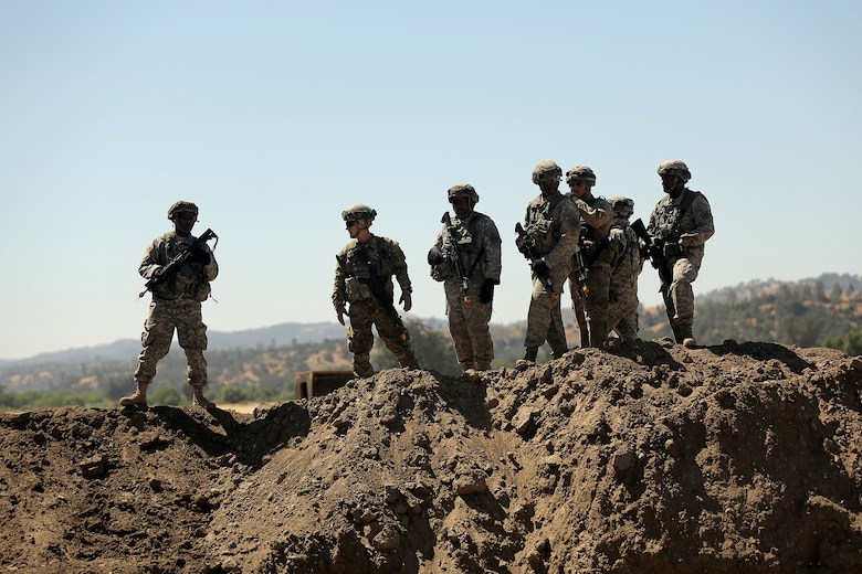 U.S. Army Reserve Soldiers assigned to the 718th Engineer Company, based in Fort Benning, Ga., assess a site to improve a berm in order to place a fuel blivets, a collapsible tank, during Combat Support Training Exercise 91-17-03, July 18, 2017 at Fort Hunter Liggett, Calif. Approximately 5,000 Army Reserve and National Guard forces participated in the exercise. First Army provided about 65 observer coach/trainers to augment their Army Reserve partners at the 91st Training Division and assist in training the most capable, combat-ready and lethal federal reserve force in the history of the nation.