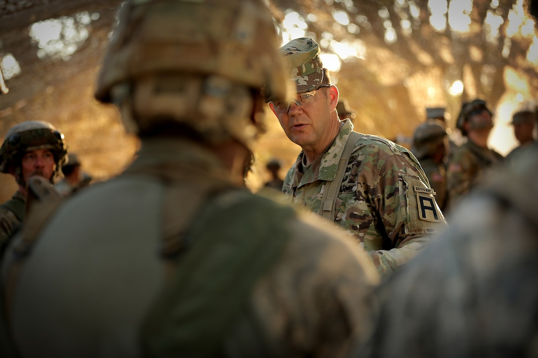 Maj. Gen. Todd McCaffrey, right, commanding general of First Army Division East, meets with Army Reserve Capt. Ciera Jackson, commander of the 208th Transportation (Palletized Loading System) Company, based in Marana, Arizona, during Combat Support Training Exercise 91-17-03, July 18, 2017, at Fort Hunter Liggett, Calif. The 208th Transportation Company is an Army Early Response Force unit that must be ready to deploy with very short notice. Approximately 5,000 Army Reserve and National Guard forces participated in the exercise. First Army provided about 65 observer coach/trainers to augment their Army Reserve partners at the 91st Training Division and assist in training the most capable, combat-ready and lethal federal reserve force in the history of the nation.  (U.S. Army photo by Master Sgt. Anthony L. Taylor)