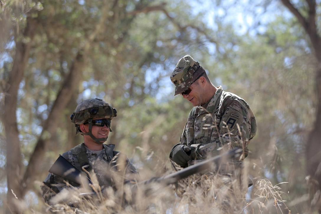 U.S. Army Reserve Spc. Adrick Montalvo, left, a Wheeled Vehicle Mechanic assigned to the 611th Quartermaster Company, based in Baltimore, Md., talks with Maj. Gen. Todd McCaffrey, commanding general of First Army Division East, during Combat Support Training Exercise 91-17-03, July 18, 2017, at Fort Hunter Liggett, Calif. Approximately 5,000 Army Reserve and National Guard forces participated in the exercise. First Army provided about 65 observer coach/trainers to augment their Army Reserve partners at the 91st Training Division and assist in training the most capable, combat-ready and lethal federal reserve force in the history of the nation. (U.S. Army photo by Master Sgt. Anthony L. Taylor)