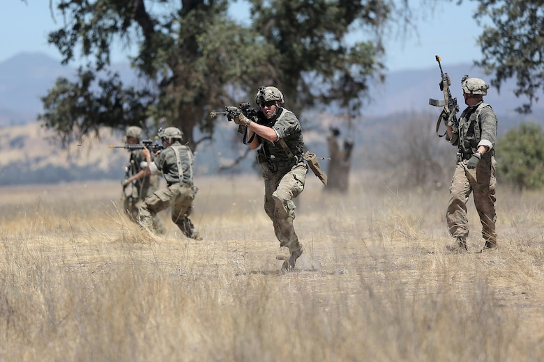 Soldiers of the 5th Battalion, 20th Infantry Regiment, based at Joint Base Lewis-McChord, Wash., engage in light attacks as the opposing force to Army Reserve and National Guard forces during Combat Support Training Exercise 91-17-03, July 18, 2017, at Fort Hunter Liggett, Calif. Approximately 5,000 Army Reserve and National Guard forces participated in the exercise. First Army provided about 65 observer coach/trainers to augment their Army Reserve partners at the 91st Training Division and assist in training the most capable, combat-ready and lethal federal reserve force in the history of the nation.