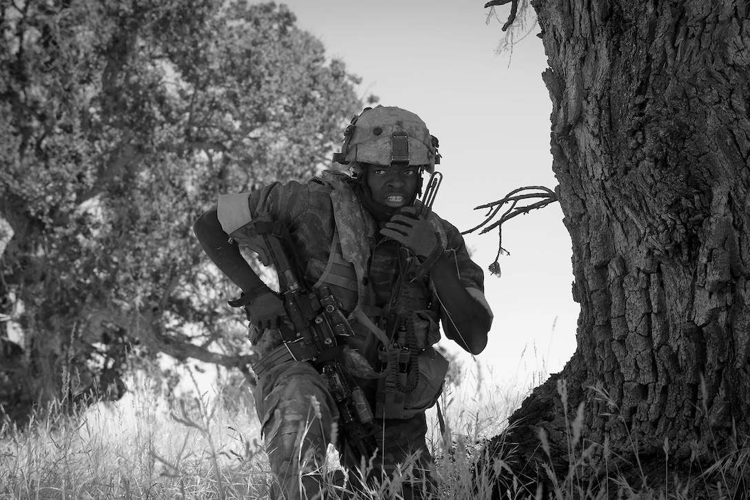 U.S. Army Staff Sgt. Andrew Burke, an infantryman with the 5th Battalion, 20th Infantry Regiment, based at Joint Base Lewis-McChord, Wash., calls his teammates, the opposing force to Army Reserve and National Guard forces, during Combat Support Training Exercise 91-17-03, July 18, 2017, at Fort Hunter Liggett, Calif. Approximately 5,000 Army Reserve and National Guard forces participated in the exercise. First Army provided about 65 observer coach/trainers to augment their Army Reserve partners at the 91st Training Division and assist in training the most capable, combat-ready and lethal federal reserve force in the history of the nation.  (U.S. Army photo by Master Sgt. Anthony L. Taylor)