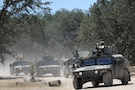 U.S. Army National Guard Soldiers of the 870th Military Police Company, based in Pittsburg, Calif., engage as a Quick Reactionary Force to an opposing force assault during Combat Support Training Exercise 91-17-03, July 18, 2017, at Fort Hunter Liggett, Calif. Approximately 5,000 Army Reserve and National Guard forces participated in the exercise. First Army provided about 65 observer coach/trainers to augment their Army Reserve partners at the 91st Training Division and assist in training the most capable, combat-ready and lethal federal reserve force in the history of the nation.