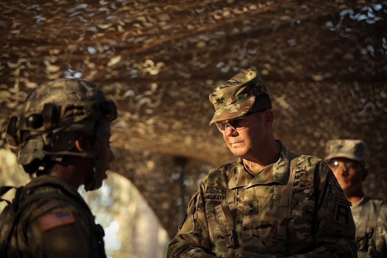 Maj. Gen. Todd McCaffrey, right, commanding general of First Army Division East, meets with Army Reserve Capt. Ciera Jackson, commander of the 208th Transportation (Palletized Loading System) Company based in Marana, Arizona, during Combat Support Training Exercise 91-17-03, July 18, 2017, at Fort Hunter Liggett, Calif. The 208th Transportation Company is an Army Early Response Force unit that must be ready to deploy with very short notice. Approximately 5,000 Army Reserve and National Guard forces participated in the exercise. First Army provided about 65 observer coach/trainers to augment their Army Reserve partners at the 91st Training Division and assist in training the most capable, combat-ready and lethal federal reserve force in the history of the nation. 