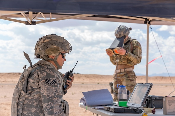 Senior Airman Alexandra Haytasingh (left) and Airman 1st Class Jedidiah Burlando work together to navigate the RQ-11B Raven DDL during the first training qualification program on the unmanned aircraft system for the Air Force at McGregor Range, N.M., July 6.