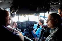 Col. Tony Polashek (right) 934th Airlift Wing commander, talks with Honorary Commanders in the cockpit of a C-130. (Air Force Photo/Paul Zadach)