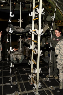 PETERSON AIR FORCE BASE, Colo. – The 21st Medical Group, along with the 302nd Airlift Wing, conducted joint training with Airmen from the U.S. Air Force Academy and Schriever Air Force Base to show proper loading and unloading procedures for casualties on a C-130 Hercules aircraft, July 14, 2017 at Peterson AFB, Colorado. Wounded Airmen can be stacked five high and flown to medical facilities for treatment around the world.(U.S. Air Force photo by Robb Lingley)