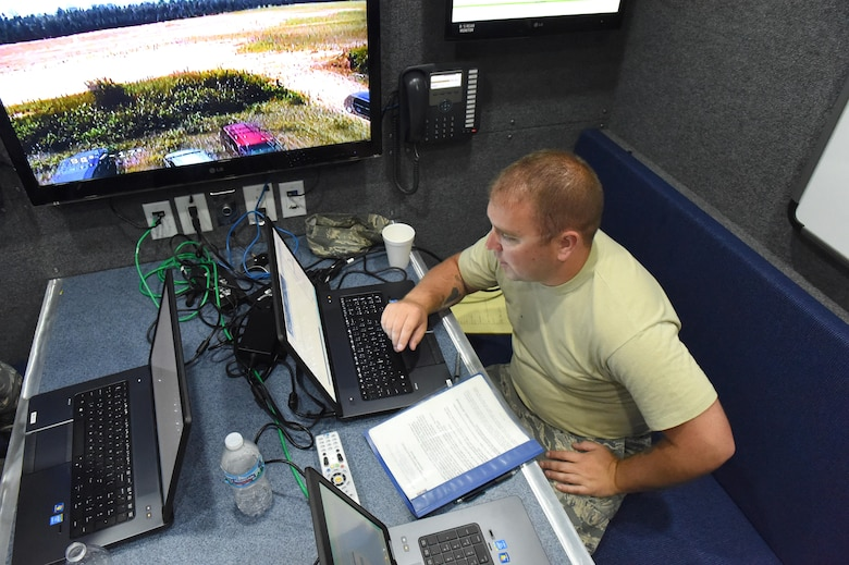 Tech. Sgt. Joeseph Stickel, a Cyber Transportation technician, works on making a quick reference guide for the 132d Wing's Mobile Emergency Operations Center (MEOC) on July 19, 2017 at Fort McCoy, Wis. The PATRIOT North 2017 exercise showed Stickel and Master Sgt. Brad Kuennen, a Radio Frequency Transmissions Systems Technician, many different ways of improving operations of the MEOC. (Air National Guard photo by A1C Katelyn Sprott)