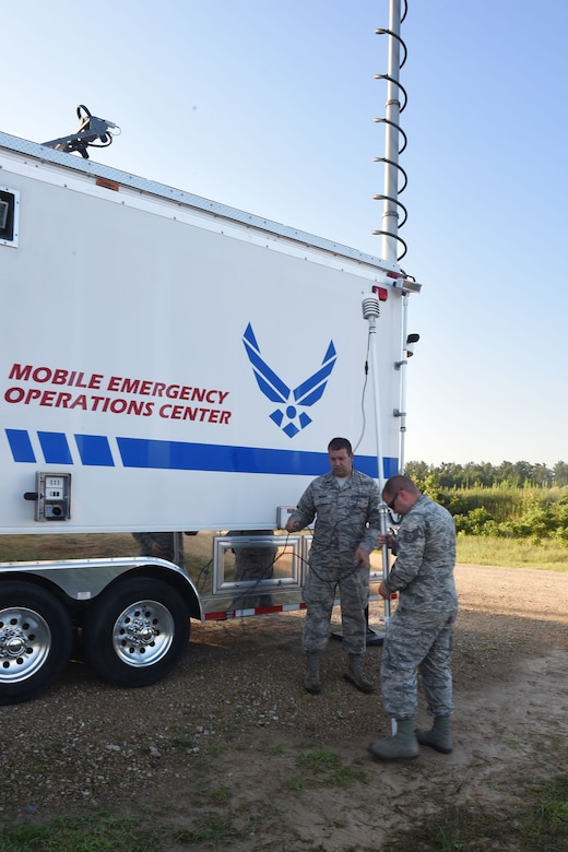 Tech. Sgt. Joeseph Stickel, a Cyber Transportation technician, and Master Sgt. Brad Kuennen, a Radio Frequency Transmissions Systems technician, place the weather station for the 132d Wing's Mobile Emergency Operations Center (MEOC) on July 19, 2017 at Fort McCoy, Wis. The weather station provides numbers for wind direction and temperature, among other things, so that Stickel and Kuennen can monitor weather conditions in support of PATRIOT North 2017. (Air National Guard photo by A1C Katelyn Sprott)