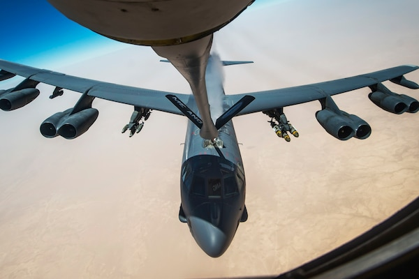 An Air Force B-52 Stratofortress aircraft receives fuel from a 340th Expeditionary Air Refueling Squadron KC-135 Stratotanker during a flight in support of Operation Inherent Resolve, July 18, 2017. The B-52 is a long-range, heavy bomber capable of flying at altitudes up to 50,000 feet. Air Force photo by Staff Sgt. Trevor T. McBride