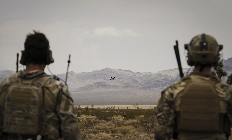 Joint terminal attack controllers watch an A-10 Thunderbolt II attack aircraft during a show of force on the Nevada Test and Training Range July 19, 2017. The A-10s wide combat radius, and short takeoff and landing capability permit operations in and out of locations near front lines. (U.S. Air Force photo by Senior Airman Kevin Tanenbaum/Released)