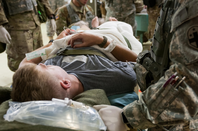 U.S. Army Reserve Spc. Zachary A. Morrill, a military policeman with the 304th Medical Company in Bluefield, West Virginia, waits for treatment during a mass casualty exercise at the 47th Combat Support Hospital, in Camp Roberts, California July 17, 2017. The CSH is part of the 84th Training Command's Combat Support Training Exercise and the Army Medical Command's Global Medic Exercise headquartered out of Fort Hunter Liggett, California. (U.S. Army Reserve photo by Spc. Miguel Alvarez, 354th Mobile Public Affairs Detachment)