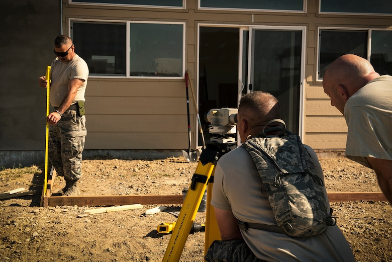 Pavement and construction equipment specialists with the 182nd Civil Engineer Squadron, Illinois Air National Guard, take measurements while building a concrete form during annual training in Crow Agency, Mont., July 24, 2017. The squadron helped build homes for Native American veterans as part of the Department of Defense's Innovative Readiness Training civil-military relations program. (U.S. Air National Guard photo by Tech. Sgt. Lealan Buehrer)