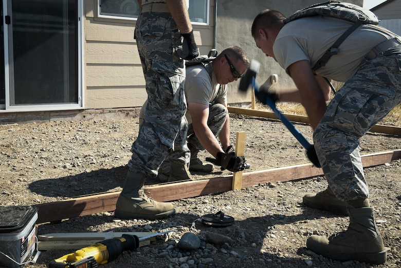 Pavement and construction equipment specialists with the 182nd Civil Engineer Squadron, Illinois Air National Guard, build a concrete form during annual training in Crow Agency, Mont., July 24, 2017. The squadron helped build homes for Native American veterans as part of the Department of Defense's Innovative Readiness Training civil-military relations program. (U.S. Air National Guard photo by Tech. Sgt. Lealan Buehrer)