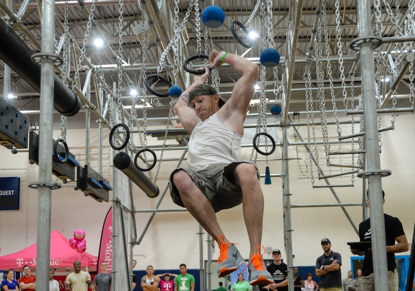 A Team Scott member participates in the Alpha Warrior challenge obstacle course. The event took place July 18-19 at the James Sports Center.