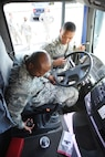 """AVIANO AIR BASE, Italy -- Senior Airman Dennis Gipson, a 301st Fighter Wing Logistics Readiness Squadron vehicle operator, is getting """"stick-time"""" instruction as part of his annual tour requirement from Senior Airman Keymontae Clark, a 31st Fighter Wing LRS ground transportation member, here. Vehicle operators are required to be qualified and able to drive several vehicles like this semi-truck. (U.S. Air Force photo by Tech. Sgt. Jeremy Roman)"""