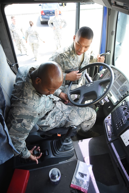 "AVIANO AIR BASE, Italy -- Senior Airman Dennis Gipson, a 301st Fighter Wing Logistics Readiness Squadron vehicle operator, is getting ""stick-time"" instruction as part of his annual tour requirement from Senior Airman Keymontae Clark, a 31st Fighter Wing LRS ground transportation member, here. Vehicle operators are required to be qualified and able to drive several vehicles like this semi-truck. (U.S. Air Force photo by Tech. Sgt. Jeremy Roman)"