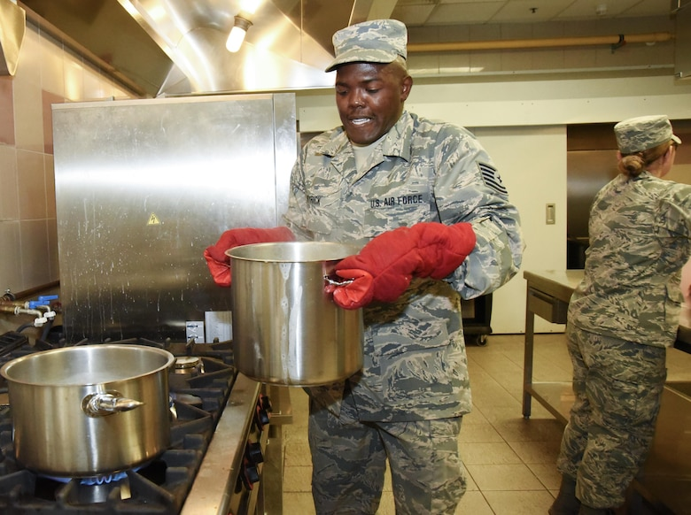 AVIANO AIR BASE, Italy -- Tech. Sgt. Brandon Wyrick, a 301st Fighter Wing Force Support Squadron food service technician, prepares to strain a fresh pot of spaghetti from boiling water and take it to the serving line at La Dulce Vida Dining Facility at Aviano Air Base, Italy.  Working stations during their annual tour included food preparation, cooking, baking, serving on the line, fruit bar, salad bar, cashier, beverages, dishes and clean-up to name a few. (U.S. Air Force photo by Tech. Sgt. Jeremy Roman)