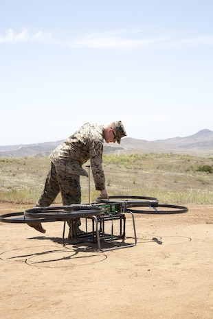 A UAV pilot with 1st Marine Raider Support Battalion, U.S. Marine Corps Forces, Special Operations Command, preps the Joint Tactical Aerial Resupply Vehicle (JTARV) for transport from a simulated forward operating base to a Marine Special Operations Company in the field aboard Marine Corps Base Camp Pendleton, Calif., July 7, 2017. The unit conducted machine-gun sustainment training with a cargo unmanned logistics system (C-ULS) during a tactical readiness exercise (TRX) aboard Marine Corps Base Camp Pendleton, Calif., July 6-11, 2017.