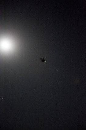 A Joint Tactical Aerial Resupply Vehicle (JTARV) flies through the night with cargo it retrieved from a Marine Special Operations Team (MSOT) with 1st Marine Raider Support Battalion, U.S. Marine Corps Forces, Special Operations Command, aboard Marine Corps Base Camp Pendleton, Calif., July 11. The JTARV, which is in the developmental phase, is a lightweight autonomous vehicle which provides an aerial resupply capability for immediate support to operational units. It was being tested as a resupply platform for machine-gun sustainment training with a cargo unmanned logistics system (C-ULS) during their TRX.