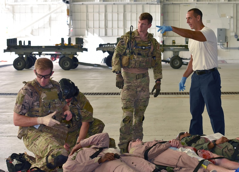 Matthew Martines, right, 45th Civil Engineer Squadron firefighter, and 1st Lt. Ryan Kelly, 38th Rescue Squadron combat rescue officer, work through the logistics of gathering active shooter exercise victims for transport to the hospital July 25, 2017 in Hangar 750. The installation firefighters and 308th Rescue Squadron pararescuemen worked closely at the scene of the crime to ensure the victims were cared for and safely transported to the hospital. Kelly is on temporary duty with the 308th RQS from Moody Air Force Base, Georgia. The exercise was a joint endeavor between the host 45th Space Wing and 920th Rescue Wing. (U.S. Air Force photo/Tech. Sgt. Lindsey Maurice)