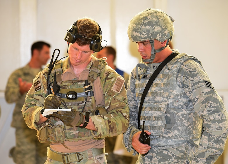 First Lt. Ryan Kelly, 38th Rescue Squadron combat rescue officer, works with Staff Sgt. Jesse Ouverson, 45th Security Forces Squadron defender, to assess the victims of an active shooter exercise incident July 25, 2017 in Hangar 750. Kelly, who is on temporary duty with the 308th Rescue Squadron, and the pararescue team oversaw the care of the victims until the 45th Civil Engineer Squadron firefighters arrived. The exercise, which ran early morning through mid afternoon, was a joint endeavor between the host 45th Space Wing and 920th Rescue Wing. (U.S. Air Force photo/Tech. Sgt. Lindsey Maurice)