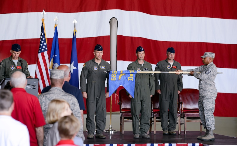 U.S. Air Force members from the 173rd Fighter Wing and 550th Fighter Squadron, stand at attention as the Detachment 2 flag is rolled up during an activation ceremony, July 21, 2017, at Kingsley Field in Klamath Falls, Oregon. The active duty Air Force detachment assigned to Kingsley Field, previously Detachment 2, is now officially designated as the 550th Fighter Squadron. 550th Fighter Squadron members will continue to fall under the command of the 56th Operations Group at Luke Air Force Base, Arizona. (U.S. Air National Guard photo by Staff Sgt. Penny Snoozy)