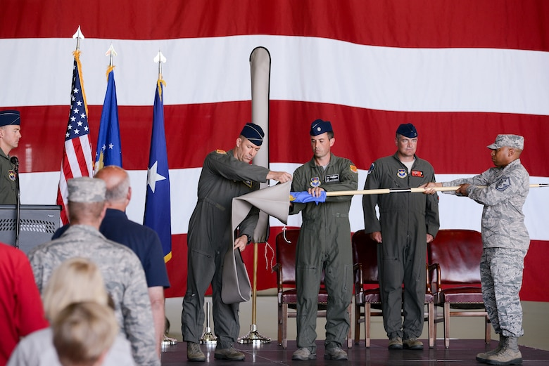U.S. Air Force members from the 173rd Fighter Wing and 550th Fighter Squadron stand at attention as the Detachment 2 flag is rolled up and covered during an activation ceremony, July 21, 2017, at Kingsley Field in Klamath Falls, Oregon. The active duty Air Force detachment based out of the Kingsley Field, previously Detachment 2, is now officially designated as the 550th Fighter Squadron. 550th Fighter Squadron members will continue to fall under the command of the 56th Operations Group at Luke Air Force Base, Arizona. (U.S. Air National Guard photo by Staff Sgt. Penny Snoozy)