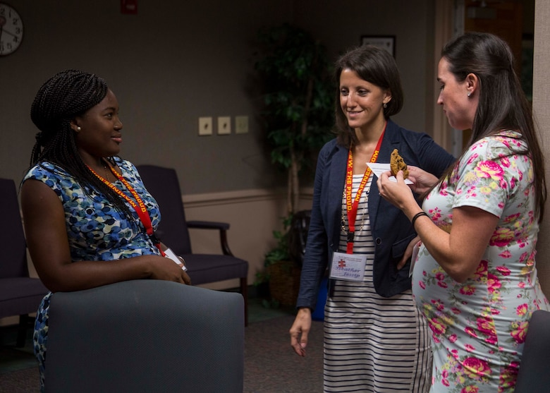 Heather N. Jessip, the L.I.N.K.S.\LifeSkills Trainer with 6th Marine Corps District (6MCD), middle, speaks with spouses during the District Spouse Orientation Course (DSOC) at Irby's Inn aboard Marine Corps Air Station Beaufort, South Carolina, July 25, 2017.  The DSOC provided Marines and their spouses a broad spectrum of tools to help them transition into the Marine Corps' recruiting field. The spouses came from across the District to build connections and network with fellow spouses. (U.S. Marine Corps photo by Lance Cpl. Jack A. E. Rigsby)