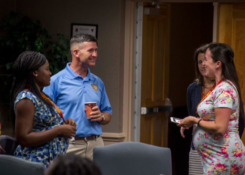 Colonel Jeffery C. Smitherman, Commanding Officer of 6th Marine Corps District (6MCD), speaks with spouses during the District Spouse Orientation Course (DSOC) at Irby's Inn aboard Marine Corps Air Station Beaufort, South Carolina, July 25, 2017.  The DSOC provided Marines and their spouses a broad spectrum of tools to help them transition into the Marine Corps' recruiting field. The spouses came from across the District to build connections and network with fellow spouses. (U.S. Marine Corps photo by Lance Cpl. Jack A. E. Rigsby)