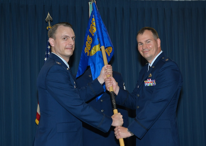 Lt. Col. James Wright takes command of the 57th Intelligence Squadron, 363rd Intelligence, Surveillance and Reconnaissance Wing, 25th Air Force, July 14, 2017. Presenting him with the squadron's guidon is Col. Michael Johanek, director, Intelligence, Surveillance and Reconnaissance, U.S. Air Force Warfare Center, and commander, 365th ISR Group, who officiated the ceremony.