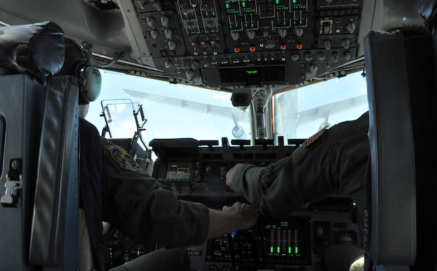 Majs. Matthew Abele and Malcom Westberry, both 301st Airlift Squadron C-17 Globemaster III pilots, close in on a KC-10 Extender during an in-air refueling over northern California on July 22, 2017. The aircraft, both from Travis Air Force Base, Calif., were performing training flights in conjunction with the 349th Air Mobility Wing's Patriot Wyvern exercise. (U.S. Air Force photo by Senior Airman Shelby R. Horn/Released)