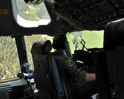 Maj. Matthew Abele, a 301st Airlift Squadron C-17 Globemaster III pilot, performs low-level flying and terrain-masking techniques over northern California on July 22, 2017. The flight was performed in conjunction with the 349th Air Mobilty Wing's Patriot Wyvern exercise. (U.S. Air Force photo by Senior Airman Shelby R. Horn/Released)