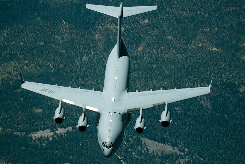 A C-17 Globemaster III from the 301st Airlift Squadron, 349th Air Mobility Wing, Travis Air Force Base, Calif., is refueled by a KC-10 Extender, July 20, 2017. The C-17 Globemaster III was conducting a local training mission in Northern California. (U.S. Air Force photo Louis Briscese)