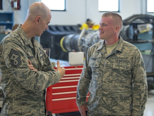 Air National Guard Command Chief Master Sgt. Ronald Anderson talks with Staff Sgt. Evin Hamm during a visit to McLaughlin Air National Guard Base July 26, 2017. Lt. Gen. L. Scott Rice, Director of the ANG and Anderson gained insight into the 130th AW mission and recognized the accomplishments of some of the unit's outstanding Airmen through a coining ceremony. (U.S. Air National Guard photo by Tech. Sgt. De-Juan Haley)