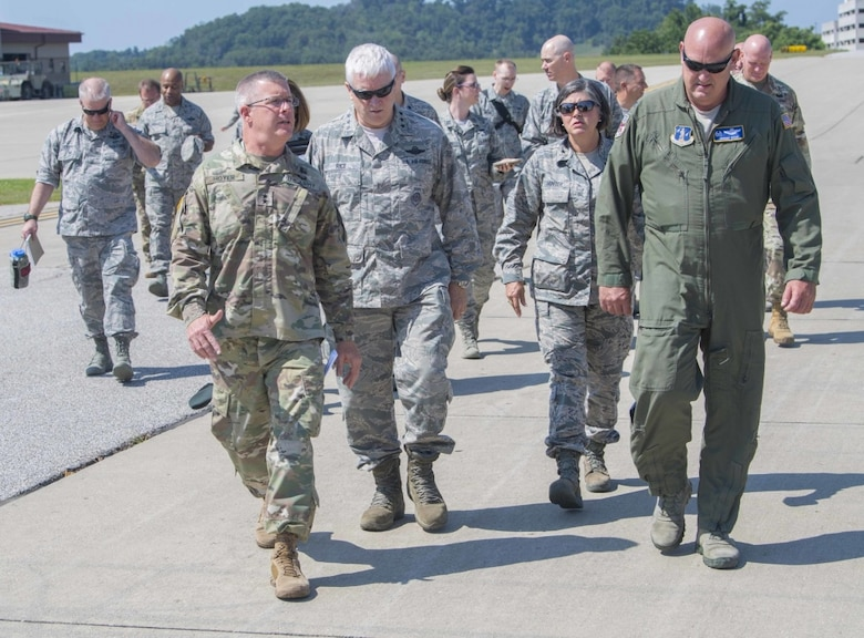 Maj. Gen. James A. Hoyer, the Adjutant General of the West Virginia National Guard, walks alongside Director of the Air National Guard, Lt. Gen. L. Scott Rice, Assistant Adjutant for Air, Brig. Gen. Paige Hunter, and 130th Airlift Wing commander, Col. Johnny Ryan during a visit to McLaughlin Air National Guard Base July 26, 2017. Rice and Air National Guard Command Chief Master Sgt. Ronald Anderson gained insight into the 130th AW mission and recognized the accomplishments of some of the unit's outstanding Airmen through a coining ceremony. (U.S. Air National Guard photo by Tech. Sgt. De-Juan Haley)