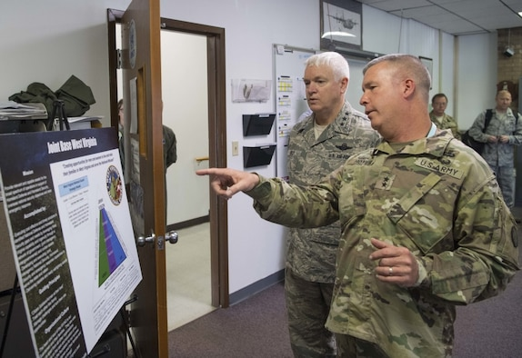 Maj. Gen. James A. Hoyer, the Adjutant General of the West Virginia National Guard, discusses the structure of Joint Base West Virginia with Director of the Air National Guard, Lt. Gen. L. Scott Rice, during a visit to McLaughlin Air National Guard Base July 26, 2017. Rice and Air National Guard Command Chief Master Sgt. Ronald Anderson gained insight into the 130th AW mission and recognized the accomplishments of some of the unit's outstanding Airmen through a coining ceremony. (U.S. Air National Guard photo by Tech. Sgt. De-Juan Haley)