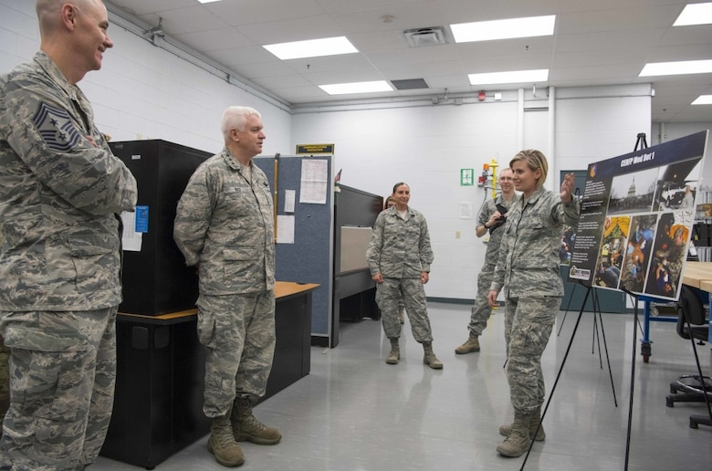 Director of the Air National Guard, Lt. Gen. L. Scott Rice, receives a briefing on the capabilities of the Chemical, Biological, Radiological and Nuclear Enhanced Response Force – Package (CERF-P) Detachment 1 from Senior Airman Sarah Smith. Smith relayed her work in the CERF-P and the value of the unit to domestic response in West Virginia and the National Capital region. (U.S. Air National Guard photo by Tech. Sgt. De-Juan Haley)
