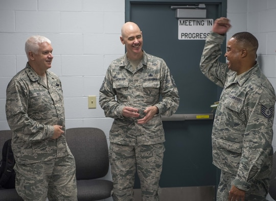 Director of the Air National Guard, Lt. Gen. L. Scott Rice, and ANG Command Chief Master Sgt. Ronald Anderson, laugh with 130th Airlift Wing recruiter, Tech. Sgt. Anthony Sherrod, during a visit to McLaughlin Air National Guard Base July 26, 2017. Sherrod was one of five Airmen to receive a challenge coin from Rice and Anderson and was lauded for being one of the state's leading recruiters with over thirty enlistments in the fiscal year. (U.S. Air National Guard photo by Tech. Sgt. De-Juan Haley)