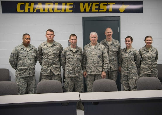 Director of the Air National Guard, Lt. Gen. L. Scott Rice, and ANG Command Chief Master Sgt. Ronald Anderson, pose with Tech. Sgt. Anthony Sherrod, Staff Sgt. Randy Downs, Tech. Sgt. Jeffery Jackson, Senior Airman Mallory Ranker, and Airman 1st Class Autumn Davis after a coining ceremony held July 26, 2017 at McLaughlin Air National Guard Base, Charleston, W.Va. Rice and Anderson recognized the outstanding accomplishments of the Airmen for their contributions to the mission and heroism off duty. (U.S. Air National Guard photo by Tech. Sgt. De-Juan Haley)