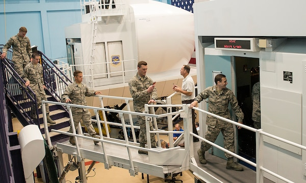 Reserve Officer Training Corps cadets enter the C-5 flight simulator at the 733rd Training Squadron, July 26, 2017 at Joint Base San Antonio-Lackland. The cadets also visited the 433rd Maintenance Squadron's engine shop and received a C-5M Super Galaxy aircraft tour. (U.S. Air Force photo by Benjamin Faske)