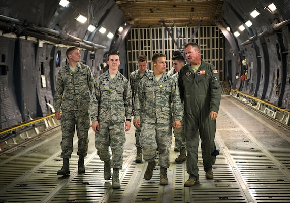 Maj. Chris Lytle, 68th Airlift Squadron C-5M pilot, shows Reserve Officer Training Corps cadets the cargo hold of a C-5M Super Galaxy July 26, 2017, at Joint Base San Antonio-Lackland.  (U.S. Air Force photo by Benjamin Faske)