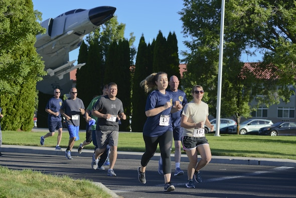 Kingsley Field members compete in the Sentry Eagle 5K run/walk July 20, 2017, at Kingsley Field in Klamath Falls, Ore. The race was also part of the Blue Zones Project ribbon cutting ceremony which designated Kingsley Field as a Blue Zones Project Approved Worksite and was followed by the Sentry Eagle 5K run/walk. The Blue Zones Project encourages changes in communities that lead to healthier options. (U.S. Air National Guard photo by Staff Sgt. Riley Johnson)