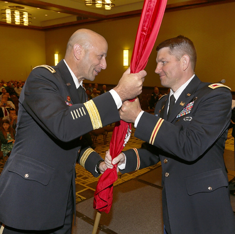 Maj. Gen. Scott Spellmon passes the district colors to Col. John Hudson, officially charging him with the responsibility of the USACE Omaha District Commander.