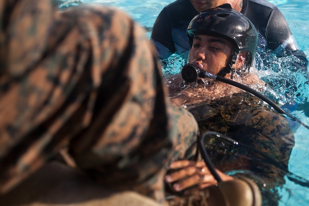A U.S. Marine practices using an Emergency Breathing System during Shallow Water Egress Training, Marine Corps Base Hawaii, July 21, 2017. In the event of an Amphibious Assault Vehicle sinking, Submerged Vehicle Egress Training and Underwater Egress Training are vital training programs that prepares Marines and Sailors on safely escaping the vehicle. (U.S. Marine Corps photo by Lance Cpl. Matthew Kirk)