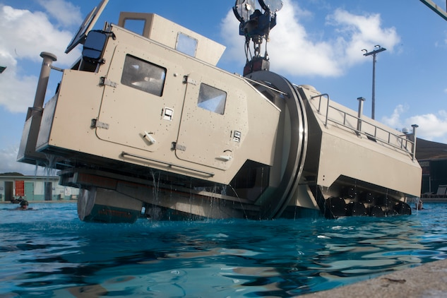 A Submerged Vehicle Egress Trainer (SVET) submerges into water during Underwater Egress Training (UET), Marine Corps Base Hawaii, July 21, 2017. In the event of an Amphibious Assault Vehicle sinking, SVET and UET are vital training programs that prepares Marines and Sailors on safely escaping the vehicle. (U.S. Marine Corps photo by Lance Cpl. Matthew Kirk)