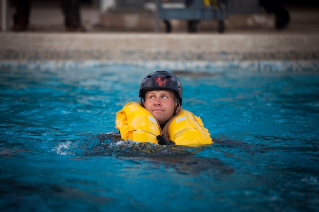 Capt. Fredrick Monday, the commanding officer of Combat Assault Company, 3rd Marine Regiment, 3rd Marine Division, treads water after escaping a Submerged Vehicle Egress Trainer (SVET) during Underwater Egress Training (UET), Marine Corps Base Hawaii, July 21, 2017. In the event of an Amphibious Assault Vehicle sinking, SVET and UET are vital training programs that prepares Marines and Sailors on safely escaping the vehicle. (U.S. Marine Corps photo by Lance Cpl. Matthew Kirk)
