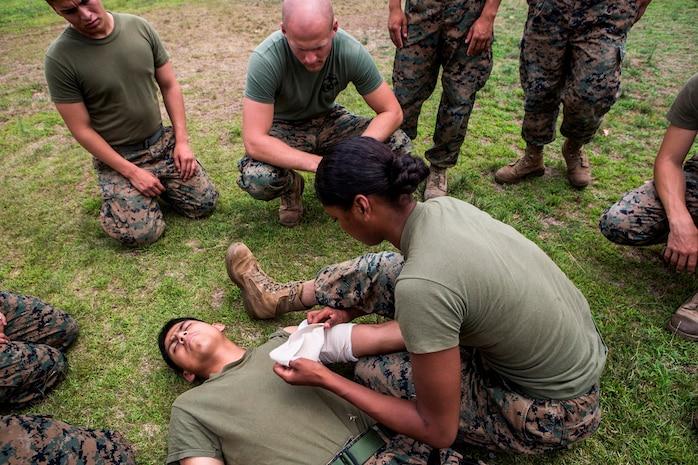 CAMP PENDLETON, Calif. – U.S. Marine Lance Cpl. Vella Jackson, a food service specialist with Food Service Company, Headquarters Regiment, 1st Marine Logistics Group, dresses a wound with gauze during the practical application portion of a combat lifesaver course July 22, 2017. The CLS course provides Marines with experience in a realistic, high stress environment, as well as instructional knowledge and techniques necessary to provide effective combat lifesaving training for medical personnel and selective Marines. (U.S. Marine Corps Photo by Lance Cpl. Joseph Sorci)