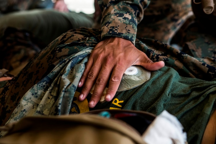 CAMP PENDLETON, Calif. – U.S. Marine Pfc. Mitchell Manuel, a field radio operator with Transportation Service Company, Combat Logistics Battalion 1, Combat Logistics Regiment 1, 1st Marine Logistics Group, applies a sucking chest wound seal during the practical application portion of a combat lifesaver course July 22, 2017. The CLS course consists of classroom instruction, practical application, and a final test day in which the Marines were evaluated on everything they had learned. (U.S. Marine Corps Photo by Lance Cpl. Joseph Sorci)